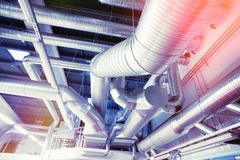 System of ventilating pipes. System of industrial ventilating pipes at factory stock photo