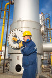 System operator in oil and gas production. With yelow helmet royalty free stock photos