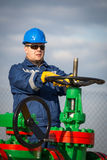 System operator in oil and gas production. With yelow helmet royalty free stock photography