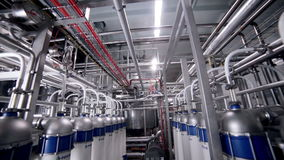 The System Pipe, pipelines with valves at modern plant, factory indoor. Pipelines with valves at modern plant, factory indoor stock footage