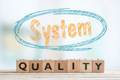 System quality sign on a table Royalty Free Stock Photography