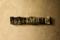 SYSTEMATIC - close-up of grungy vintage typeset word on metal backdrop Royalty Free Stock Photography