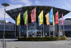 Systems Fair Flags. Brightly colored flags fly in front of the entrance to the Systems Fair in Munich, Germany Stock Image