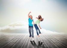 Systrar som har rolig banhoppning över träbräden Fotografering för Bildbyråer