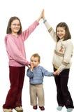 systrar tre Arkivfoto