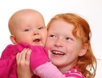 systrar två Arkivfoto