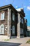 Syzran`, Russia - August, 16,2016: Side view of old wooden two-storey unpainted house. Stock Photos