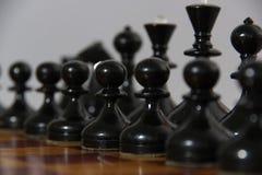 Szachowe czarny i biały postacie Obrazy Stock