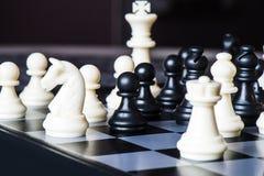 Szachy na szachowej desce Fotografia Stock