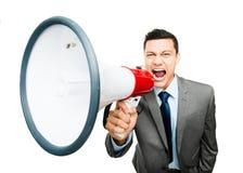 Szalony Azjatycki biznesmen krzyczy w megafonie na białym backgrou Fotografia Royalty Free