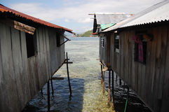 Szalunków budynki z stosami przy dennym wybrzeżem Obrazy Royalty Free
