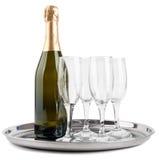 Szampańska butelka i cztery szkła Obraz Royalty Free