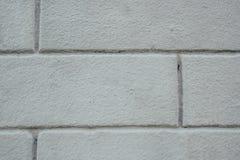 Szara ściana z cegieł zamknięta w górę zdjęcia royalty free