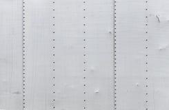 Szara metal ściana z nitami Obrazy Stock