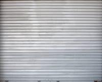 Szara rolkowa żaluzja metalu garażu brama, tekstura zdjęcie royalty free