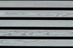 Szare drewniane deski na czarnym tle zdjęcia royalty free