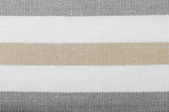 Szarego bielu pasiasta tkanina jako tło tekstura Fotografia Royalty Free