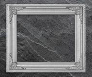 Szarość rocznika fotografii ramowa rama na marmurowym kamiennej ściany tle Zdjęcie Royalty Free