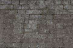 Szarość z dekoracyjną tynk ścianą z cegieł zdjęcia royalty free