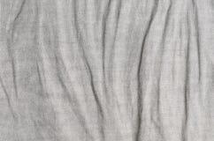 Szarości tło zmięty bieliźniany zdjęcie stock