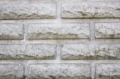 Szary cegły tło, nowożytna cegła stylizował pod dzikim kamieniem Zdjęcia Royalty Free