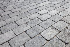 Szary ceglany miastowy bruk, tło tekstura Zdjęcie Royalty Free