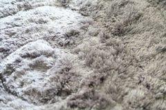 Szary owłosiony dywan jako tło, fotografia stock