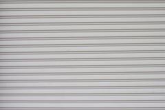 Szary rolkowy drzwi, ?aluzi tekstury drzwiowy t?o zdjęcia stock