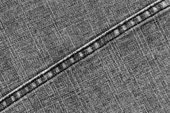 Szarych cajgów sukienna tekstura z ściegiem Zdjęcia Royalty Free