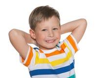Szczęśliwa śliczna młoda chłopiec zdjęcie royalty free