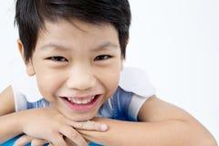 Szczęśliwa azjatykcia śliczna chłopiec z uśmiech twarzą Zdjęcie Royalty Free