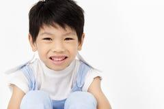 Szczęśliwa azjatykcia śliczna chłopiec z uśmiech twarzą Zdjęcia Royalty Free