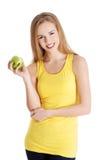 Szczęśliwa blondynki kobieta trzyma jabłka fotografia stock