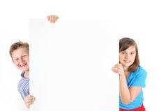 Szczęśliwa chłopiec i dziewczyna zdjęcia stock