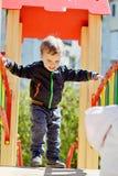 Szczęśliwa chłopiec na boisku Zdjęcia Stock