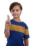 Szczęśliwa chłopiec pozuje przeciw białemu tłu zdjęcia stock