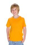 Szczęśliwa chłopiec w żółtej koszula fotografia royalty free