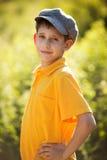 Szczęśliwa chłopiec w nakrętce Obrazy Royalty Free