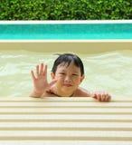 Szczęśliwa chłopiec w pływackim basenie Obraz Royalty Free