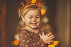 Szczęśliwa chłopiec w raindeer kostiumu fotografia stock