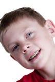 Szczęśliwa chłopiec z brasami obrazy stock
