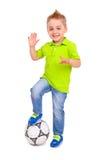 Szczęśliwa chłopiec z piłki nożnej piłką Zdjęcia Royalty Free