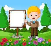 Szczęśliwa chłopiec z pustym signboard Obrazy Royalty Free