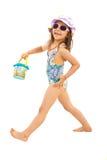 Szczęśliwa dziewczyna iść wyrzucać na brzeg Obrazy Royalty Free