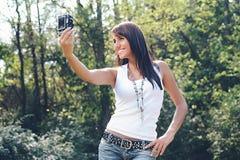 Szczęśliwa dziewczyna która fotografował Obrazy Royalty Free