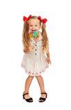 Szczęśliwa dziewczyna z wielkim lizakiem Zdjęcie Royalty Free