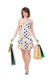 Szczęśliwa dziewczyna z zakupami. Zdjęcia Stock