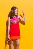 Szczęśliwa dziewczyny falowania ręka Obrazy Royalty Free