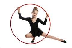 Szczęśliwa dziewczyny gimnastyczka z obręczem Zdjęcia Stock