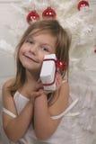szczęśliwa dziewczyny teraźniejszość fotografia stock